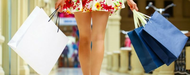 lady carrying shopping bags