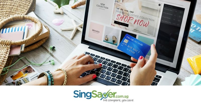 lady browsing online shop with credit card in hand