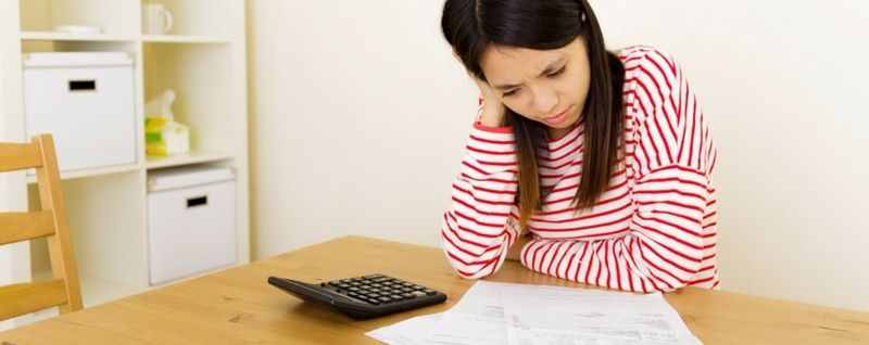 girl looking at financial statement