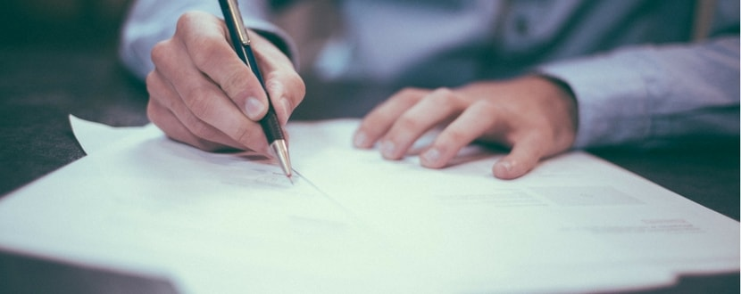 man signing a contract - SingSaver