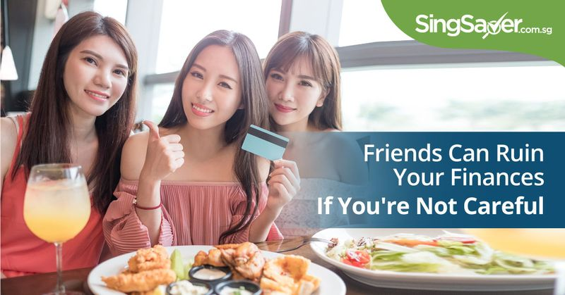 girl friends paying for their meal with a credit card