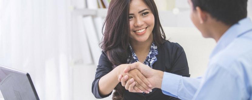promotion handshake between man and woman - SingSaver