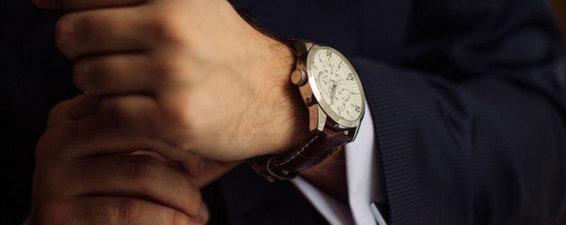 man wearing expensive watch