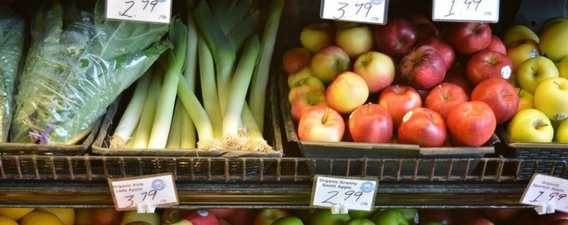 buying fruits and vegetables at the supermarket