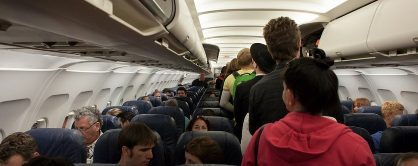 passengers queuing to get off the plane