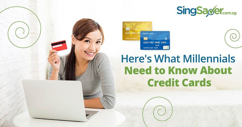 happy girl holding credit card in hand with laptop - SingSaver
