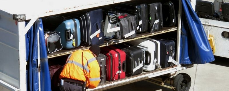 luggage being loaded-min - SingSaver