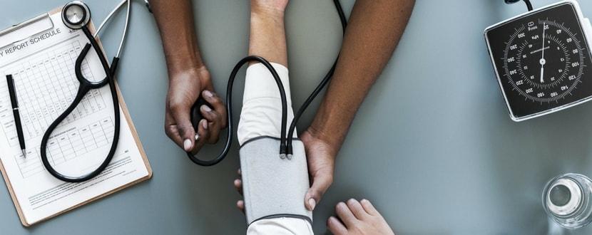 doctor checking for blood pressure - SingSaver