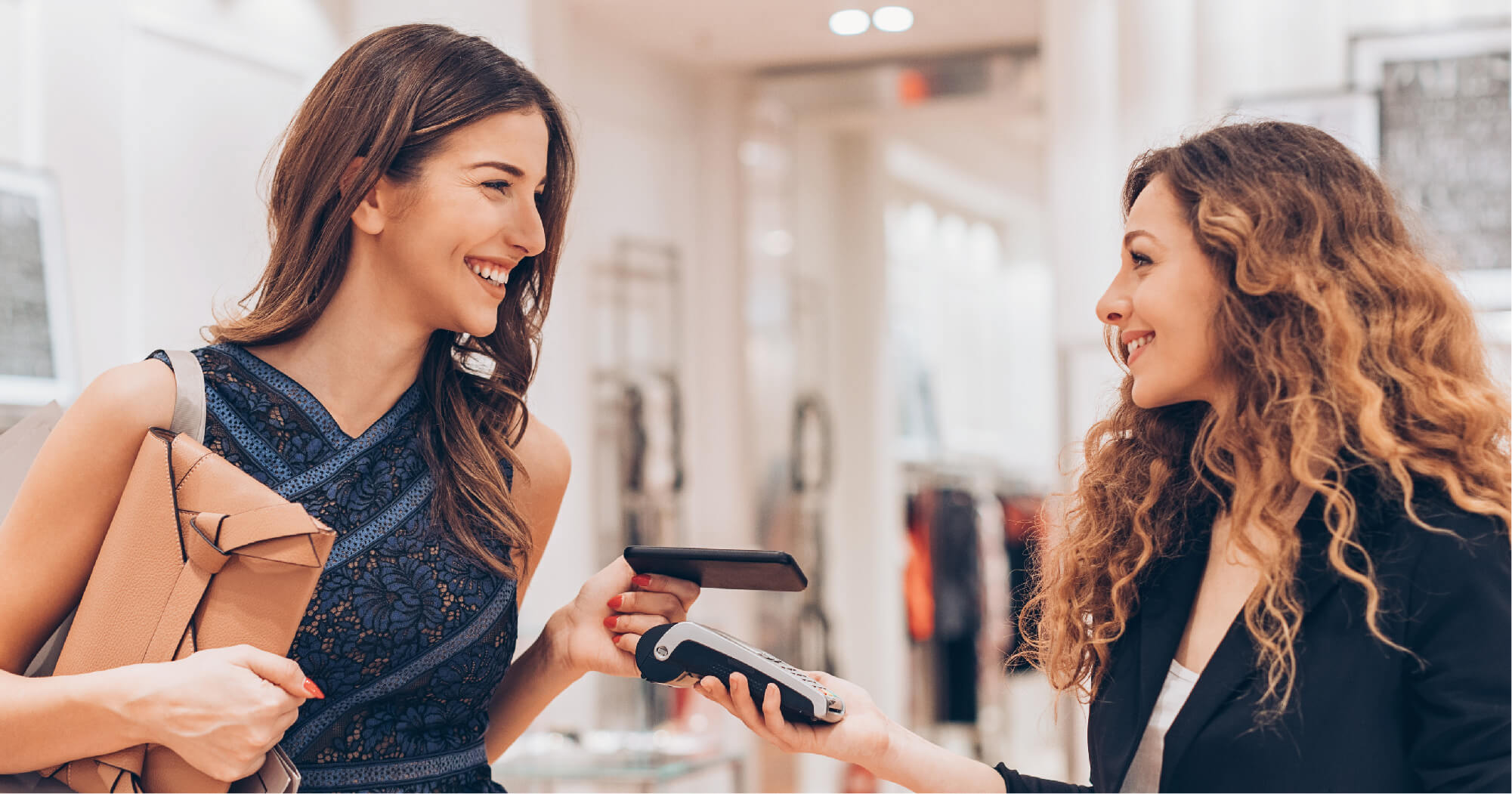 Happy people using mobile wallet payment - SingSaver