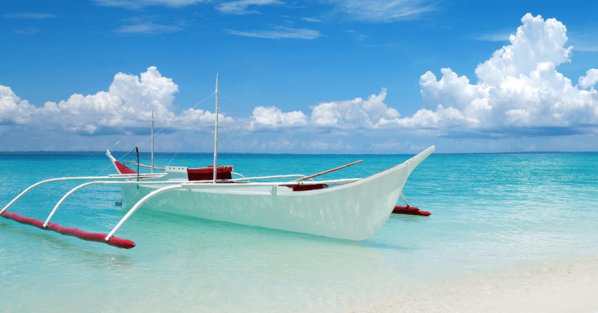 A boat on Cebu beach - SingSaver