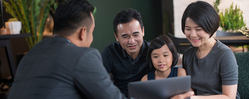 family of 3 happy looking at laptop screen information -SingSaver