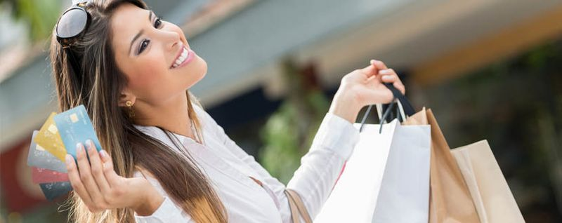 Lady with shopping bags and cards -SingSaver
