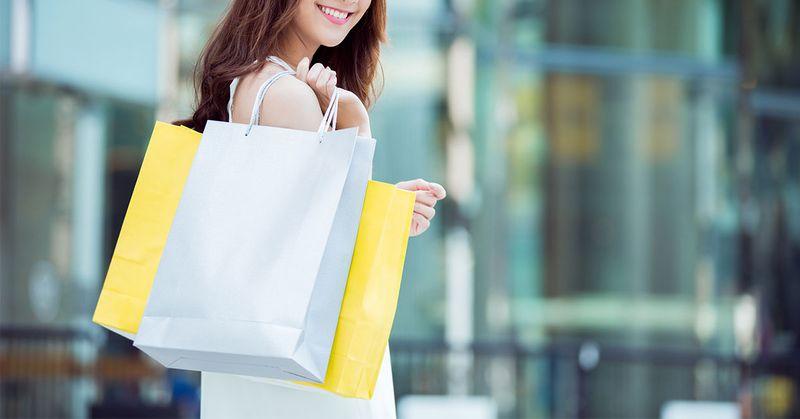 Lady holding shopping bags - SingSaver