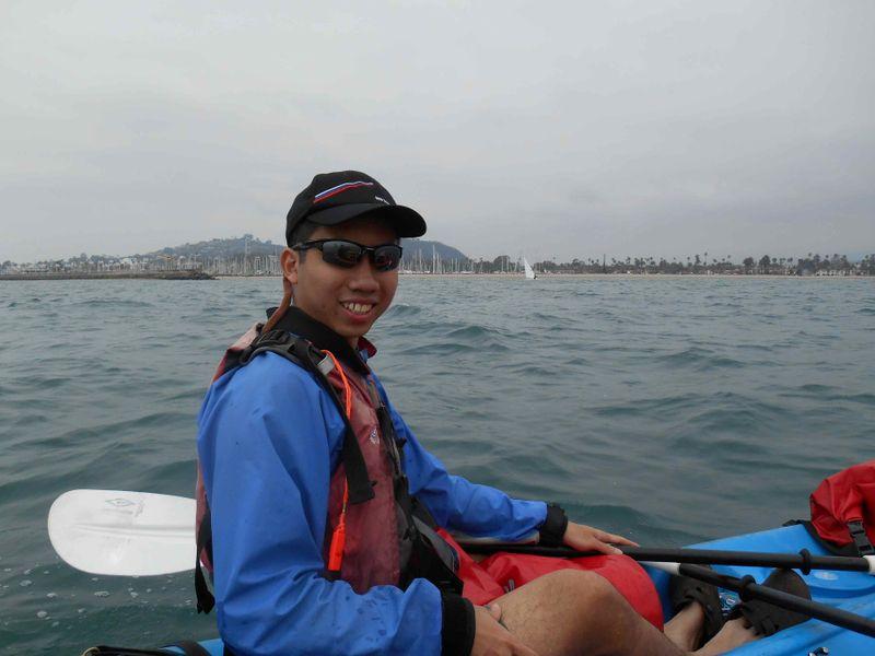 Travel hacking expert Aaron Wong, aka the MileLion, kayaking in Monterey.